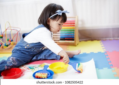 baby girl painting at home