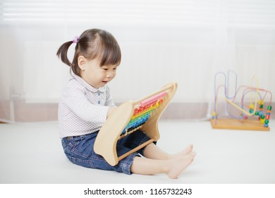 baby girl play abacus toys at home
