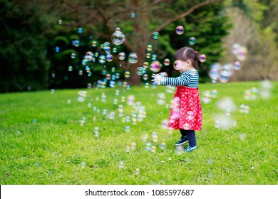 baby girl play bubble at spring garden