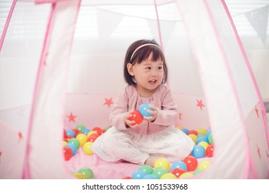 baby girl play tent and ocean ball at home