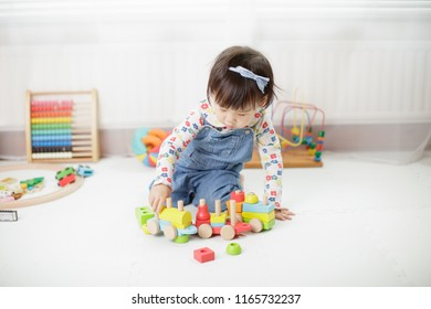 baby girl play toy blocks at home