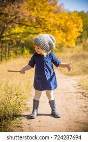 baby girl playing in autumn forest background