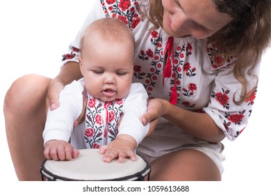 Baby girl playing drum.