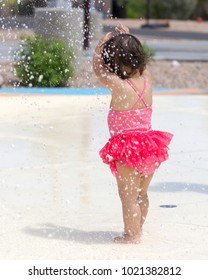 Baby Girl Playing on a Splash Pad