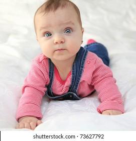 Baby girl portrait, white background