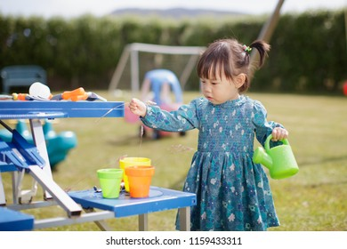baby girl  pretend play in Summer garden