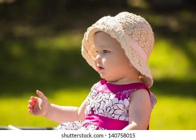 Baby girl in a purple dress