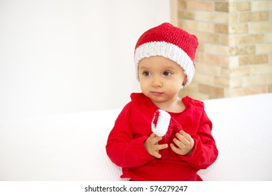 Baby girl in red costume, isolated