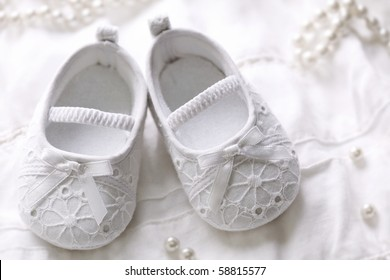 Baby girl shoes on white background