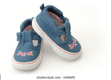 Baby Girl Shoes with Pink Flowers on White Background