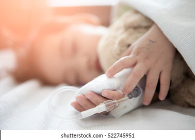baby girl sick in hospital, saline solution intravenously.