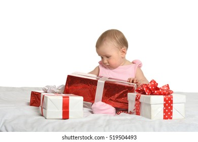 Baby girl sitting  with gifts