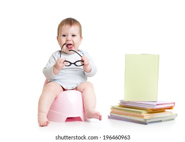 baby girl sitting on chamberpot with books