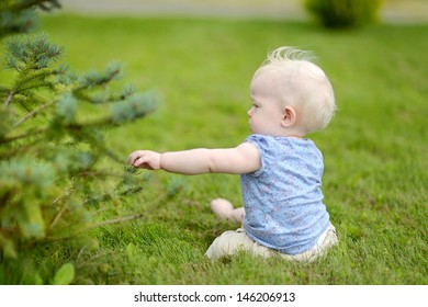Baby girl sitting on a green grass