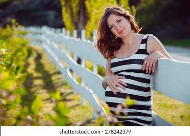 Baby girl sitting on green grass
