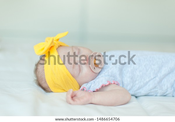 Baby girl sleeping on white bed