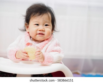 baby girl snacking time