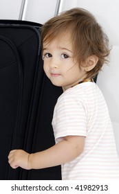 Baby girl and suitcase