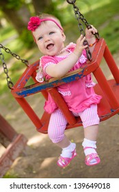 Baby girl in swing