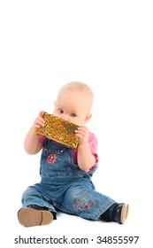 baby girl tasting a gift