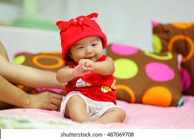Baby girl three old months wear red shirt and red hat