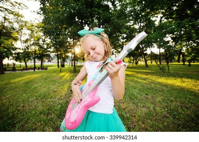 baby girl with a toy guitar