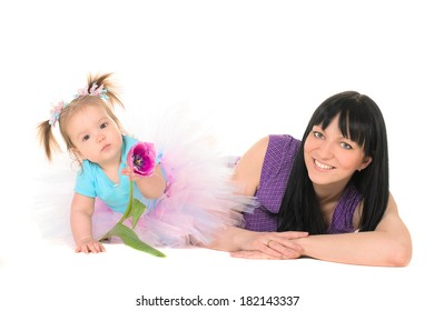 baby girl in tutu holding hands tulip for Mom. Isolated white background