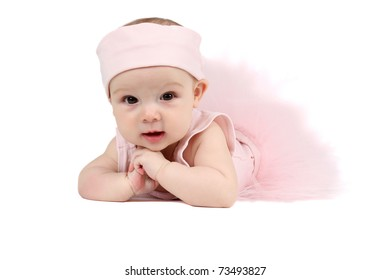 Baby girl wearing a ballet outfit and legwarmers