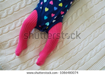 3ac14d06e Baby girl wearing pink tights and colorful onesie. Child clothing and  apparel. Kids fashion