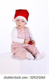 baby girl wearing santa hat on white isolated background