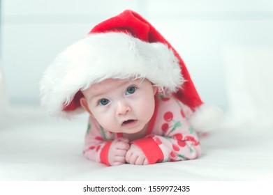 Baby girl wearing a Santa's hat Christmas white background