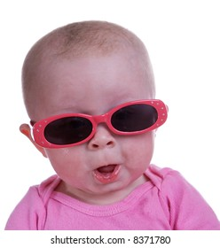 Baby girl wearing sunglasses with a cute expression