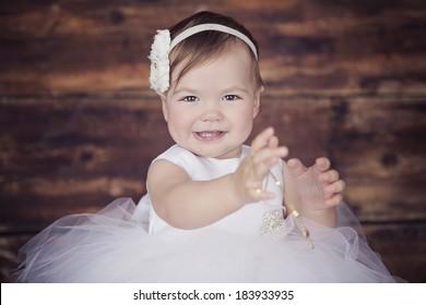 baby girl wearing a white dress