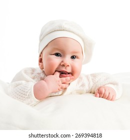 baby girl in a white cap and a jacket on a white background