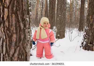 Baby girl in the winter forest