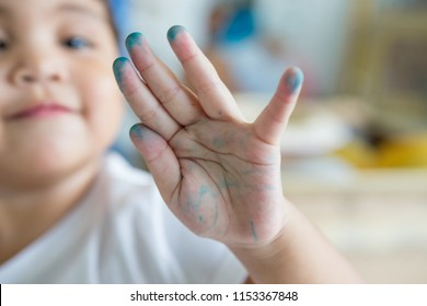 Baby girl's hand is dirty color