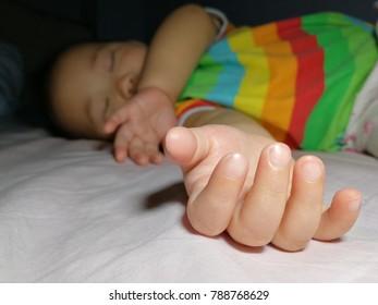 Baby girl's hand, focused shot.
