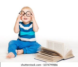 Baby in Glasses Read Book, Early Children Education, Happy Kid Boy one year old sitting over White Background
