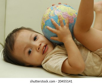 Baby and a globe