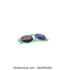 Baby green plastic sunglasses on a white background isolate.Side view