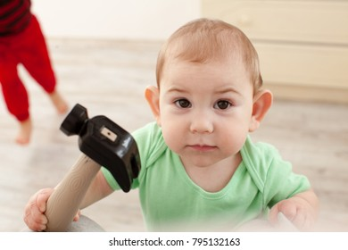 Baby with hammer intend to work