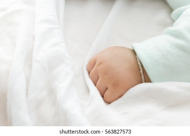 Baby hand with copy space.