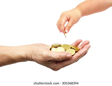 baby hand giving golden coin to hand of female elderly