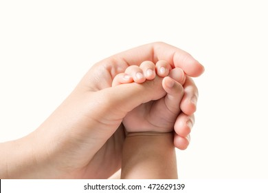 Baby hand holding finger mom on isolated background. (Selected focus)