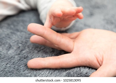 baby hand with mother hand