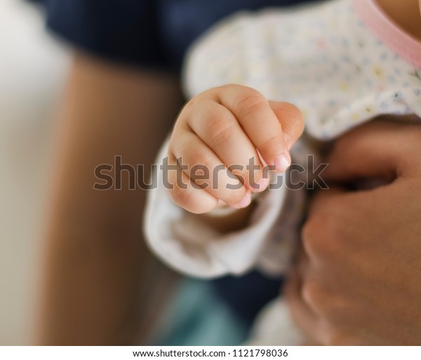 baby hand and mother hand
