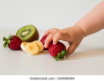baby hand picking fruits