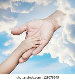 Baby hand reach out to god