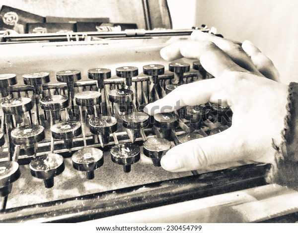 Baby hand typing on a old typewriter.