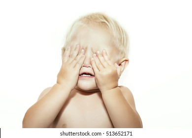 Baby hands closed eyes. On a white background